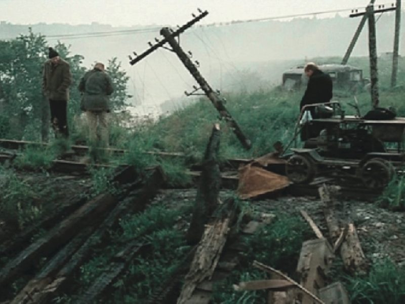 The two main characters from the movie Stalker crossing the rail-road